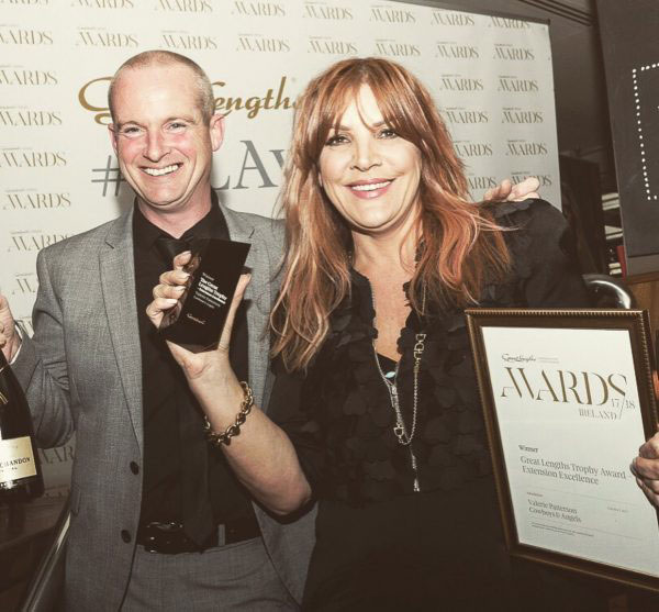 a man and a woman received an awards